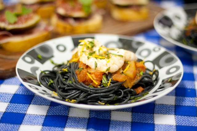 spaghetti al nero di seppia with tomatoes and shrimp sauce